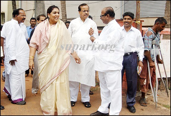 congress party workers and poor man on crutches